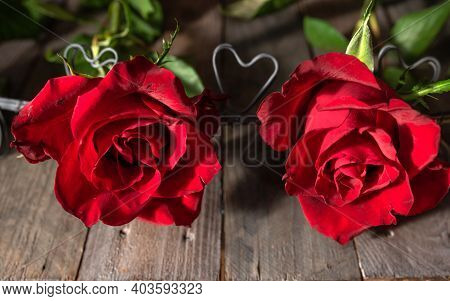 Two Red Roses With Hearts On Dark Wooden Boards. Background For Valentine's Day Greetings With Space