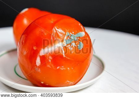 Rotten Tomato With Mold On The Plate. Close-up, Selective Shot.