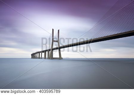 View Of The Famous Vasco Da Gama Bridge Over The Tagus River In Lisbon, Portugal. Space For Text.