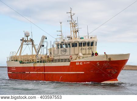Hofn I Hornafirdi Iceland - April 23. 2020: Trawler Jon A Hofi Entering Port Of Hornafjordur
