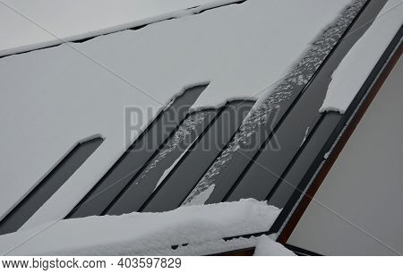 A Gray Metal Roof In A Mountain Environment Is Best For Draining Snow And Melting Snow. New Tiatan Z