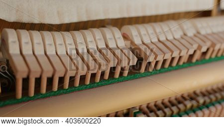 Piano hammers hit the strings