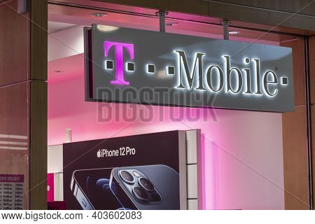 Indianapolis - Circa January 2021: T-mobile Retail Wireless Store. T-mobile Merged With Sprint In Ho