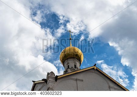 Russia, Rostov, July 2020. The Gilded Dome Of The Church In The Clearing Of The Cloudy Sky.