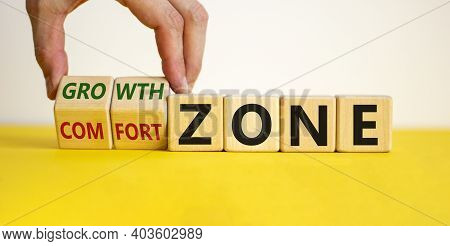 Comfort Or Growth Zone Symbol. Hand Turns Wooden Cubes And Changes Words 'comfort Zone' To 'growth Z