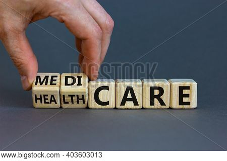 Medicare Or Healthcare Symbol. Doctor Turns Cubes, Changes The Word 'healthcare' To 'medicare'. Beau