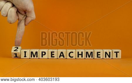 Second Impeachment Symbol. Businessman Turns Wooden Cubes And Changes Words '1 Impeachment' To '2 Im