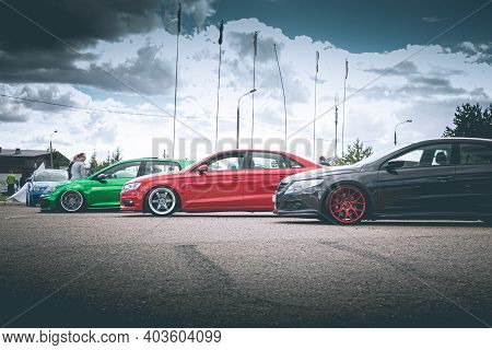 Moscow, Russia - July 6, 2019: Green Golf And Gray Passat Volkswagen And Red Audi A4 - Sports Cars A