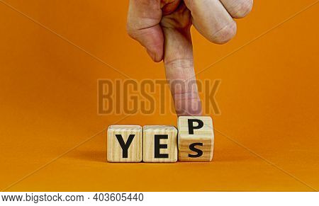 Yes Or Yep Symbol. Businessman Turns A Cube, Changes The Word 'yes' To 'yep'. Beautiful Orange Backg