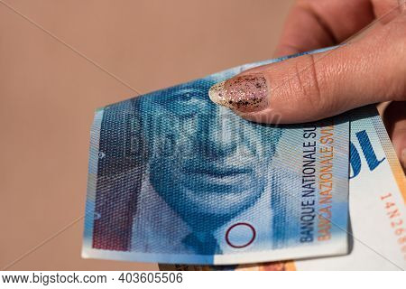 World Money Concept, Close Up Of 100 Swiss Franc Banknote, Photo Of Chf Currency Isolated. Hand Hold