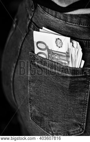 Banknotes Close Up, Money In A Jeans Pocket. Euro Stick Out Of The Jeans Pocket, Finance And Currenc