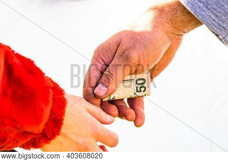 Hand Giving Money Like Bribe Or Tips Isolated, Hard Worked Hand Taking Dollars Money. Currency Trans