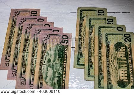 Money On The Table, Us Dollars On White Table. Business Concept