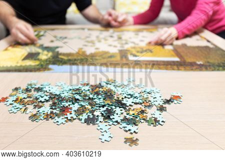 Coronavirus Family Doing Puzzle To Have Fun In Confinement Due To Pandemic