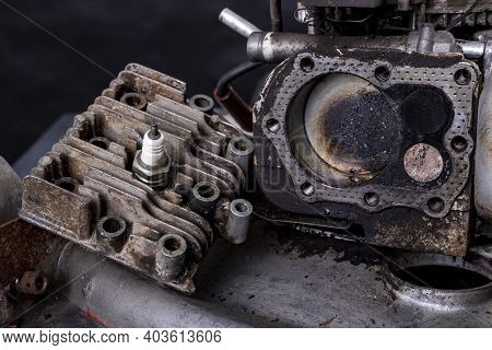 Repair Of A Small Internal Combustion Engine From A Lawn Mower. Head, Cylinder And Piston Of A Four-