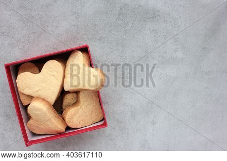 Valentines Heart Shaped Cookies In A Kraft Gift Box On A Gray Concrete Background. Flat Lay Food. Co
