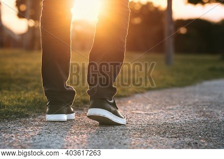 Man Walking Outdoors In The Park At Sunset. Man On His Way To A New Better Life. The Way Forward. Ne