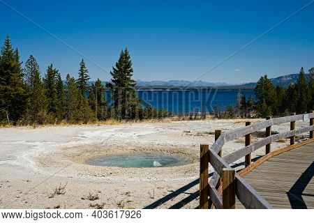 A Small Bubbling Hot Spring In West Thumb Geyser Basin At Yellowstone National Park, With Yellowston