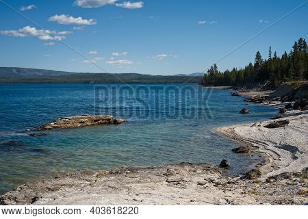The Shoreline Of Yellowstone Lake At West Thumb Geyser Basin In Yellowstone National Park, A Locatio