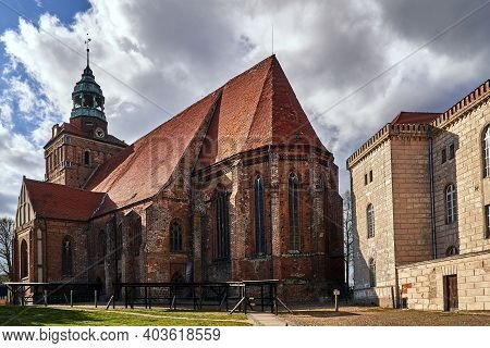 Medieval, Gothic Church With A Belfry In Osna, Poland