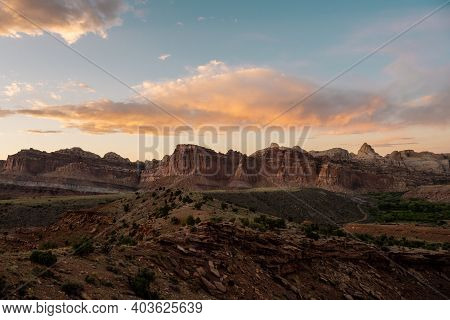 Golden Hour Over Capitol Reef Formations From The Scenic Drive