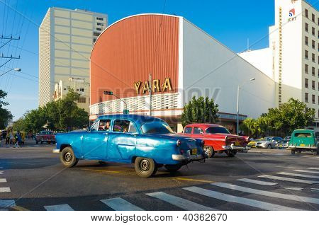HAVANA-DECEMBER 12:People and traffic at the modern neighborhood of El Vedado December 12,2012 in Havana.Founded in 1515,Havana is the largest city in the Caribbean with 2.4 million inhabitants