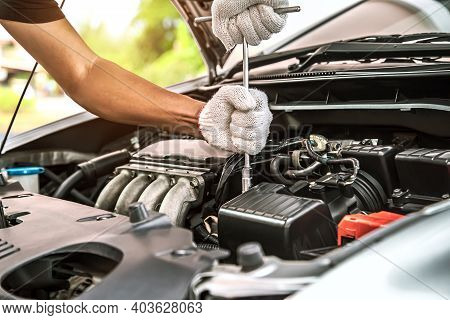Close-up Hands Of Auto Mechanic Are Using The Wrench To Repair And Maintenance Auto Engine Is Proble