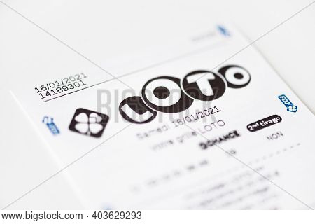 BAYONNE, FRANCE - CIRCA JANUARY 2021: Francaise des Jeux Loto receipt on white background. Loto is one of the games of Francaise des Jeux, France's national lottery operator.