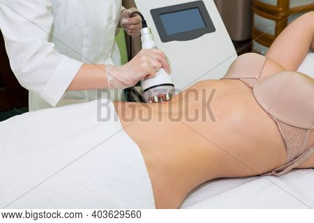 A Russian Lifting Specialist Performs A Body Shaping Procedure For A Young Woman.