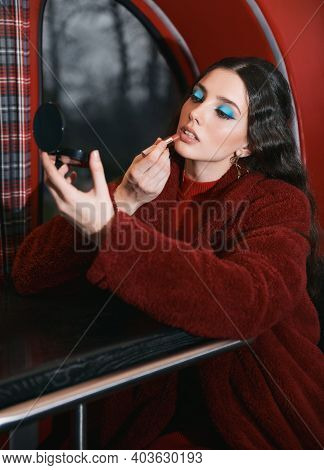 Lovely Girl Sitting In The Cafe Bus (bistro) And Painting Her Lips By Lipstick. Retro (vintage) Port