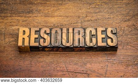 resources word abstract in vintage letterpress wood type against weathered wooden backround, business, support and supply concept
