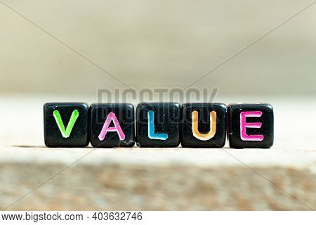 Black Color Block With Word Value On Wood Background