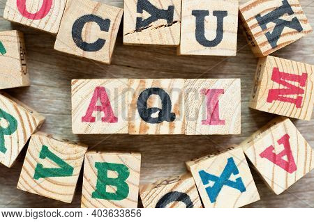 Alphabet Letter Block In Word Aqi (abbreviation Of Air Quality Index) With Another On Wood Backgroun