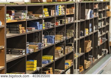 Placerville, Usa - November 25, 2020: Half Empty Shelves With Rifle And Pistol Ammo Boxes At A Gun S
