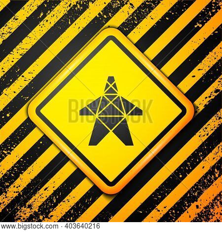 Black Electric Tower Used To Support An Overhead Power Line Icon Isolated On Yellow Background. High