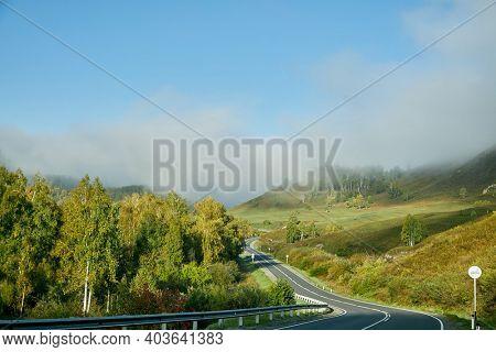 long road between green hills