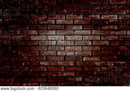 An Old Brick Wall With Deep Vignetting In Dark Colors. Background Brick Dark Vocus Light In The Midd