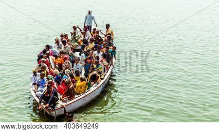 Varanasi, India - May 12, 2019 - Tourists Use Boat Ride On The Holy River Ganga And Observe The Reli