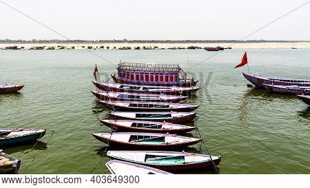 Varanasi, India - May 06, 2019 - A View Of Historic Varanasi Ghats, Ancient Temples And Buildings Al