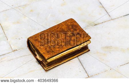 Varanasi - May 12 ,2019 - A Very Old Shri Ramcharitmanas Book Placed On White Background