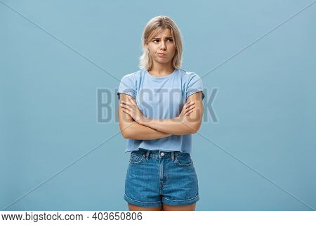 Uncertain Troubled And Perplexed Attractive Blond Woman With Tanned Skin Holding Hands Crossed On Ch
