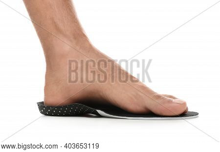 Man Fitting Orthopedic Insole On White Background, Closeup. Foot Care
