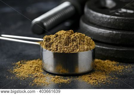 Scoop Of Hemp Vegan Protein Powder On Dark Rustic Background. Sport Nutrition.