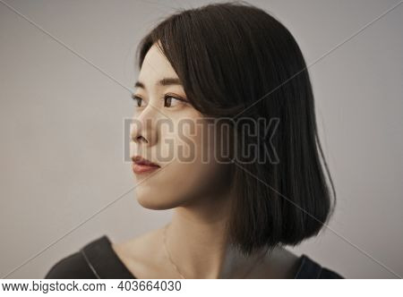portrait of young asian woman in profile
