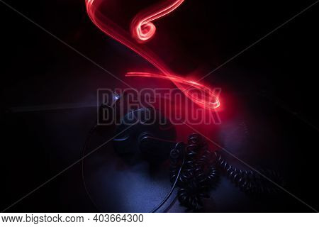 Dj Music Club Concept. Close Up Headphones On Dark Background With Colorful Light.