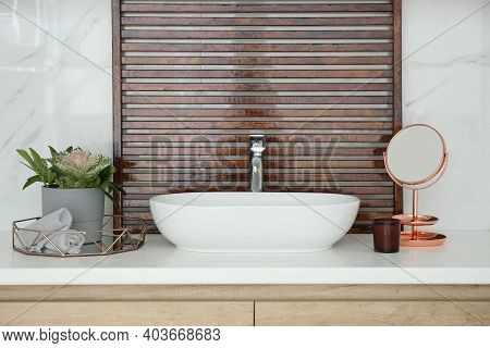 Bathroom Counter With Stylish Vessel Sink And Small Mirror. Interior Design