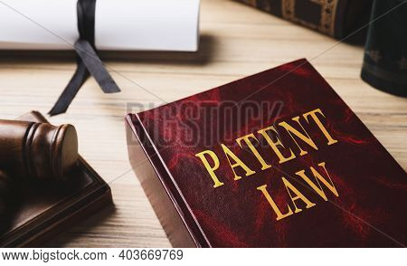 Patent Law Book On Wooden Table, Closeup