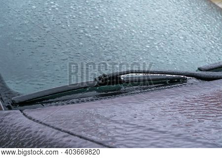 Icy Car Windshield Close-up. Icy Windshield, Wipers Of The Car Close Up
