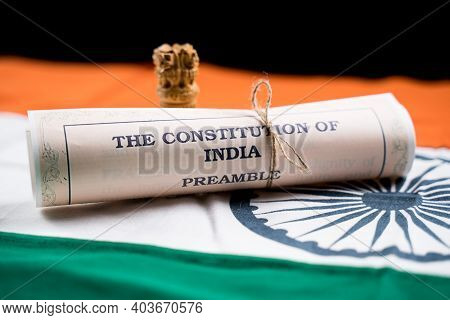 Indian Constitution Or Bharatiya Savidhana Preamble Old Scattered Text Paper Placed On Indian Flag -