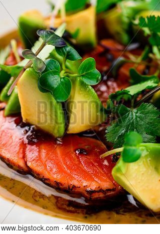 Top View Of Seared Salmon With Avocado In Bowl, Seared Salmon Salad With Sauce At A Premium Restaura